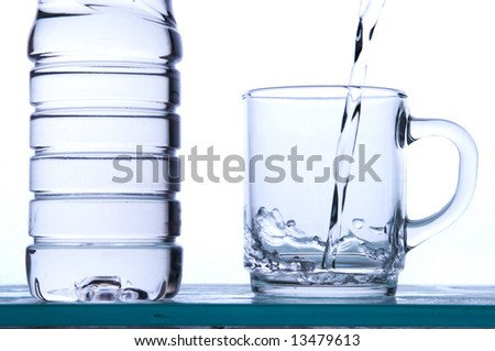 water running in a glass - stock photo