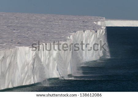 Water running off the arctic ice shelf in Svalbard, Norway - stock photo