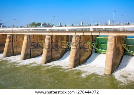 Water rushing through gates at a dam in Kanchanaburi province - stock photo