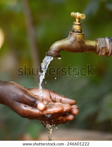 Water Scarsity Symbol - Drinking for African Children - stock photo