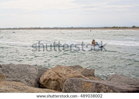 water scooter speeding to the coast with two people