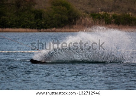 Water skiing in cable park - stock photo