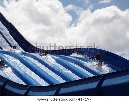 Water slide at amusement park - stock photo