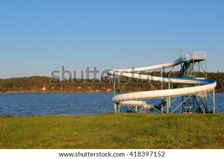 Water slide on a lake. Hracholusky dam in Czech republic, European Union. - stock photo