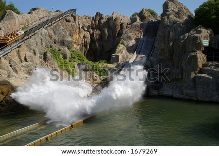 Water smash ride in amusement park. - stock photo