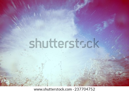 water splash against the sky and the sun. ���olorful background w - stock photo