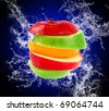 Water splash and fruits on blue background - stock photo