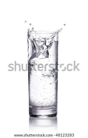 water splash in a glass.  Isolated on white background with clipping path - stock photo