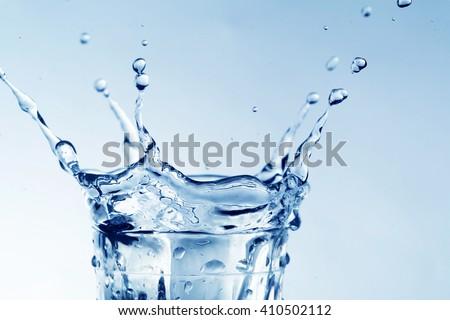 Water splash in glass macro - stock photo
