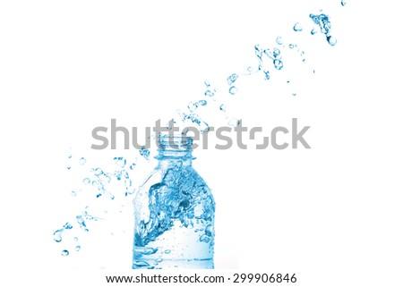 Water splash on bottle on white background - stock photo