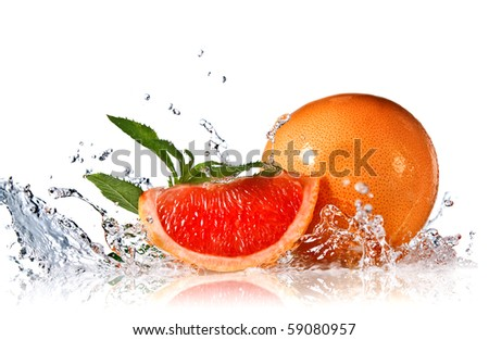 Water splash on grapefruit with mint isolated on white - stock photo