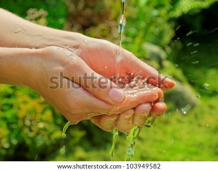 water splash on hands - stock photo