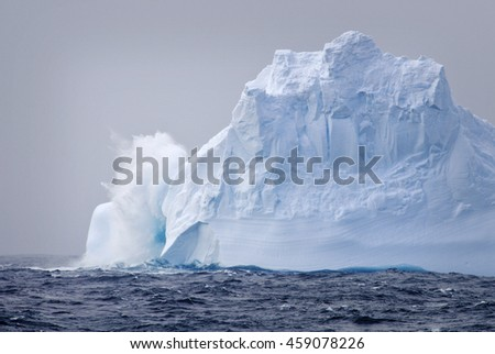 Water splash on iceberg, Antarctica