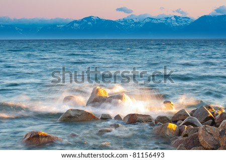 Water splash on rock with mountain in the background at Lake Tahoe, California, USA - stock photo