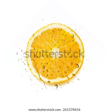 Water Splash over Sliced Orange  isolated on white background - stock photo