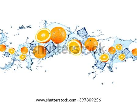 Water splash with fruits isolated on white backgroud. Fresh orange - stock photo