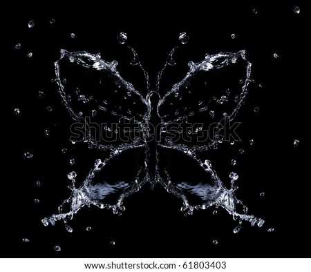 Water splashes and drops shaped as butterfly, black background isolated - stock photo