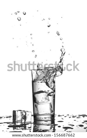 Water splashes in the glass isolated on white - stock photo