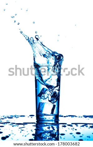 Water splashes in the glass on white background - stock photo