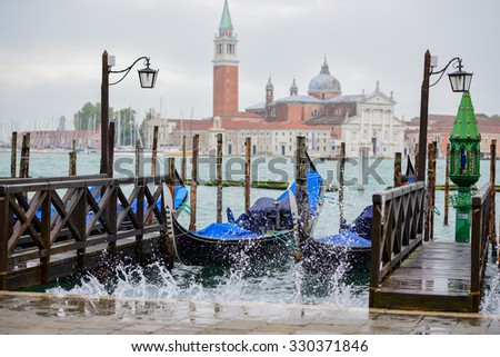 Water splashes up during rough seas in Venice, Italy