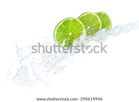 Water splashing against lime fruit slices - stock photo