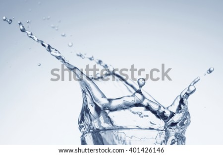 Water splashing from glass - stock photo