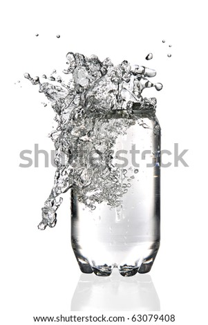 Water splashing in a transparent soda can - stock photo