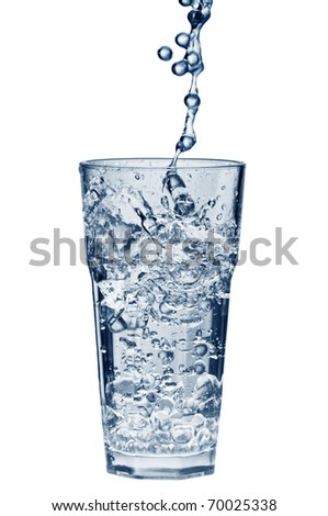 Water splashing out of a glass isolated over white background with clipping path