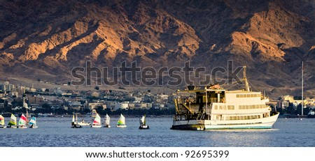 Water sport and recreation activities in the gulf of Aqaba (Red Sea), view from  Eilat city, Israel - stock photo