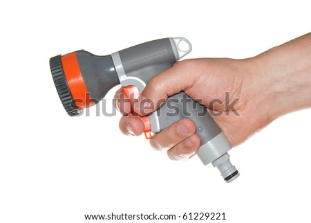 Water sprinkler in hand isolated on white. - stock photo