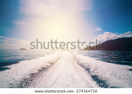 Water stream after speed boat. Vintage filter. - stock photo