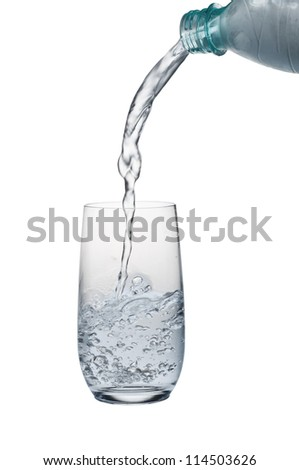 Water stream being poured into a glass isolated over white background