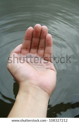 water stream on hand - stock photo