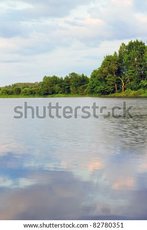 water surface with sky reflection - stock photo