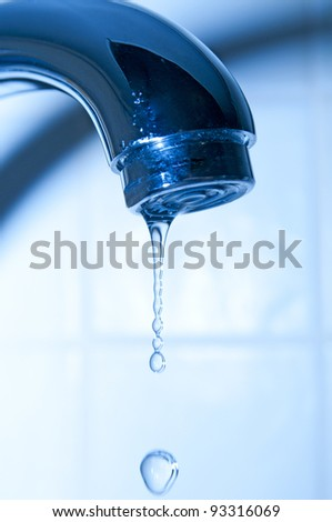Water tap and droplets - stock photo