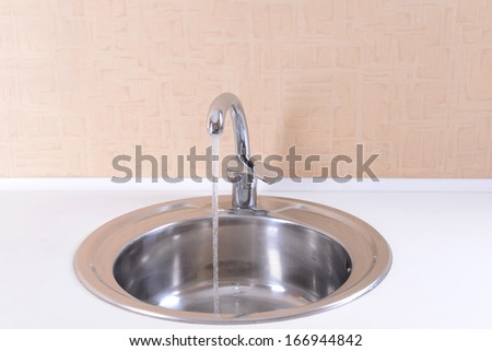 Water tap and sink in  modern kitchen - stock photo
