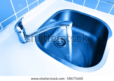 Water tap close-up with flowing fresh water. - stock photo