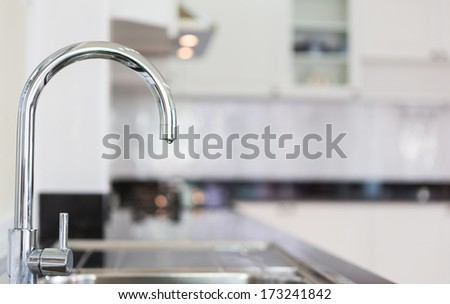 Water  tap in the kitchen - stock photo