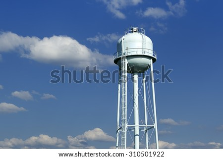 Water tower against blue sky. - stock photo