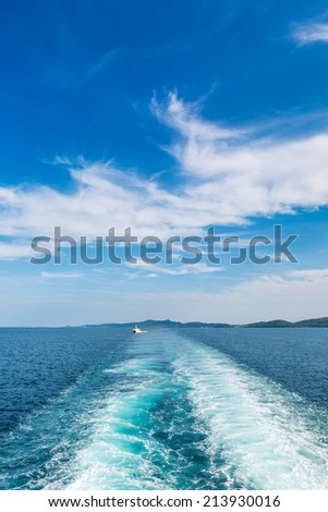 Water trail of the large ferry ship seen from the stern, on the Adriatic Sea - stock photo