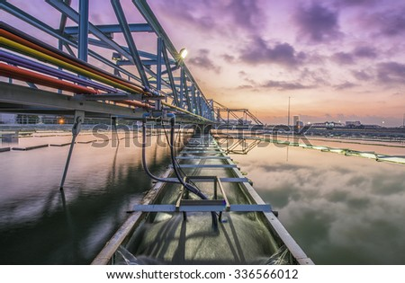 Water Treatment Plant with sunrise - stock photo