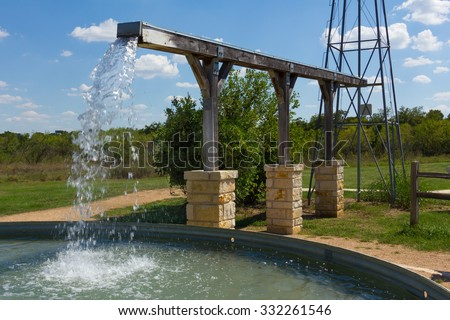 water trough and windmill base - stock photo