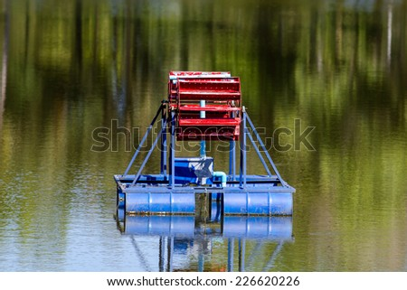 Water turbine working in pool - stock photo
