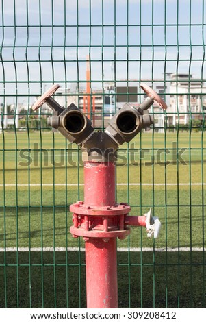 water valve in stadium for security fire - stock photo