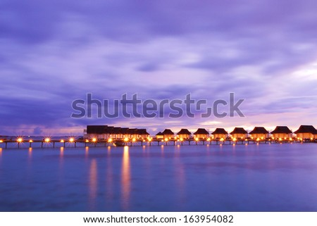Water Villas (Bungalows) on the Perfect Tropical Island, Maldives - stock photo