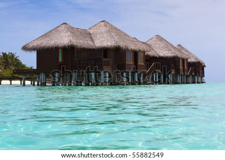 Water Villas in the Ocean. Welcome to the Paradise! Maldives. High Contrast.