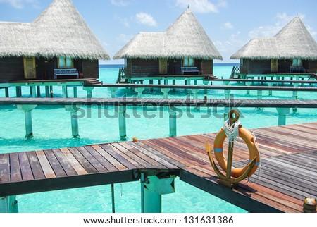 Water villas on tropical caribbean island, Maldives - stock photo