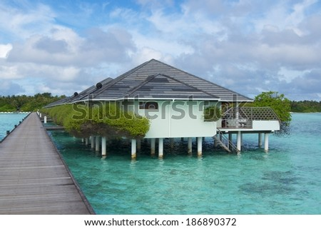Water villas on tropical island, Maldives