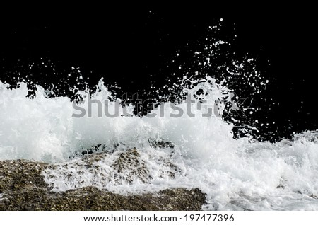 Water wave splashes, isolated on black background