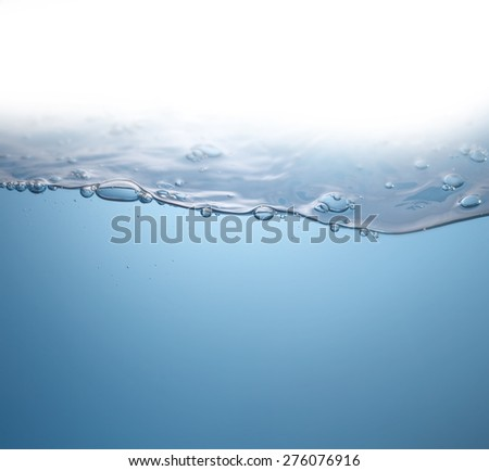 Water wave with air bubbles - stock photo
